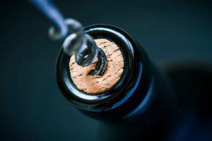 wine cork in bottle and corkscrew
